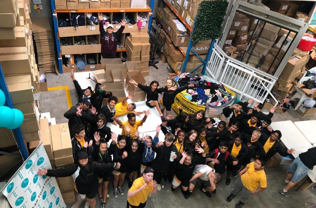 39 kids, 2 1/2 hours, 42 boxes packed, 2,645 items sorted, 40 meals prepared, and….