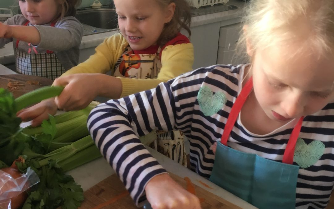 FAMILY HOLIDAY VOLUNTEERING make lunches for clients at Asylum Seekers Centre